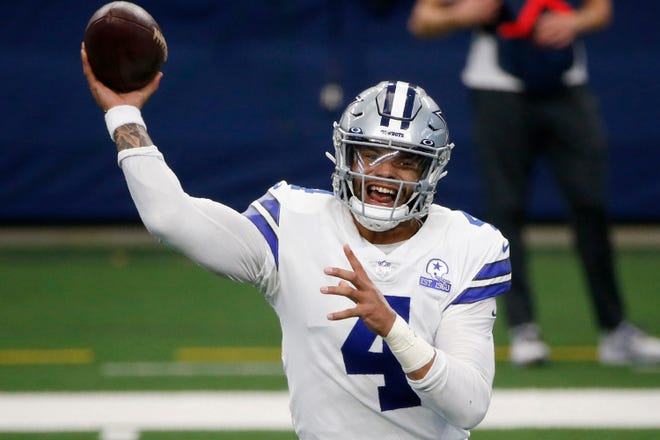 In this Oct. 11, 2020, file photo, Dallas Cowboys quarterback Dak Prescott throws a pass in the first half of a game against the New York Giants in Arlington. The NFL is returning to London in October and Tom Brady begins his pursuit of an eighth Super Bowl title against Dak Prescott and the Dallas Cowboys when Tampa Bay hosts the league's annual kickoff game on Sept. 9.