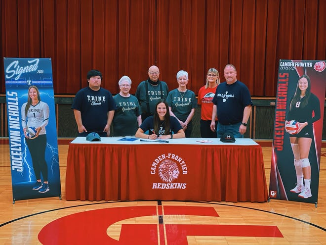Jocelynn Nicholls signs her national letter of intent to attend Trine University and join the volleyball team. Pictured with Jocelynn (From Left to Right):Mason Nicholls, Betty Nicholls, Dick Salyer, Linda Salyer, C-F Coach Dawn Follis, and Scott Nicholls.