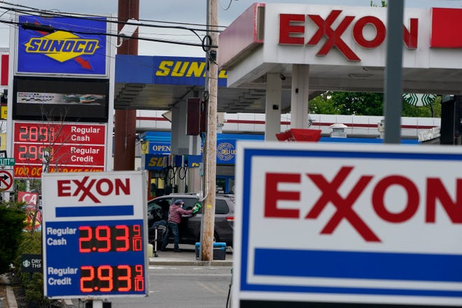 Gas stations display the price of gasoline in Leonia, N.J., Monday, May 10, 2021. (AP Photo/Seth Wenig)