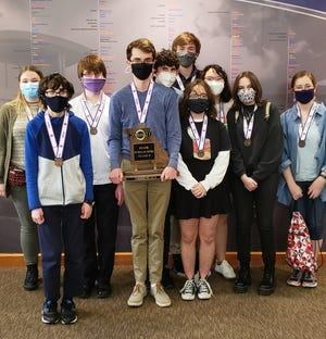 Members of the Kirksville scholar bowl team pose with the trophy they earned for finishing in third place at the Class 5 state tournament. Pictured from left to right: Addison Hodges, Thomas Thatcher, Fred Garvey, Chris Marshall, Donal Ryan, Daniel Marshall, Julia Chapman, Juni Alberts, Cassidy Albright and Caitlin Ervin.