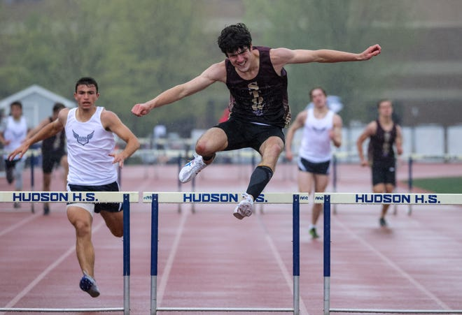 Stow-Munroe Falls senior Jo Barry clears a hurdle during a meet with Hudson earlier this spring.