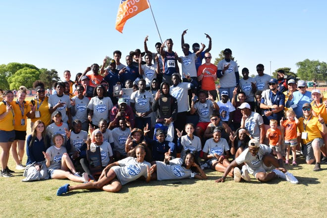 South Plains College track and field teams celebrate after winning the NJCAA outdoor championships at home Thursday in Levelland. The Lady Texans won their first outdoor national title since 2015, and the Texans won their first outdoor title since 2017, sharing it with Barton County (Kan.) Community College.