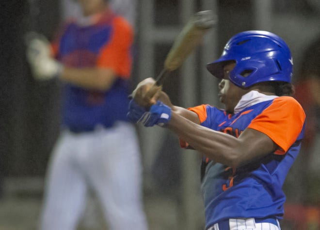 Bartow's Ray McKinzy hits an RBI-single to score his team's third run during the sixth inning against Winter Haven on Wednesday night in the Class 6A, Region 2 semifinals at Winter Haven High School's Jim Whitney Field.