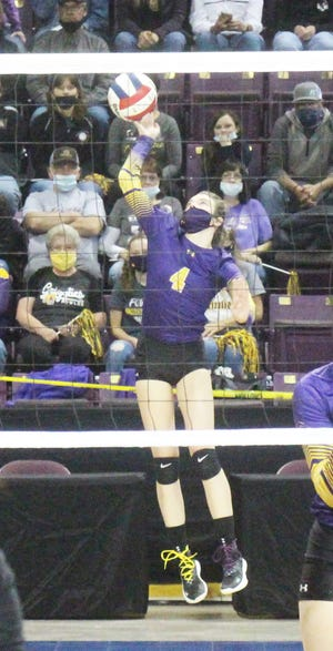 Fowler High School's Emily Flanscha with the opening serve in Thursday's Class 2A State Tournament semifinal match against Wiggins. The Grizzlies lost in three sets to end the season.