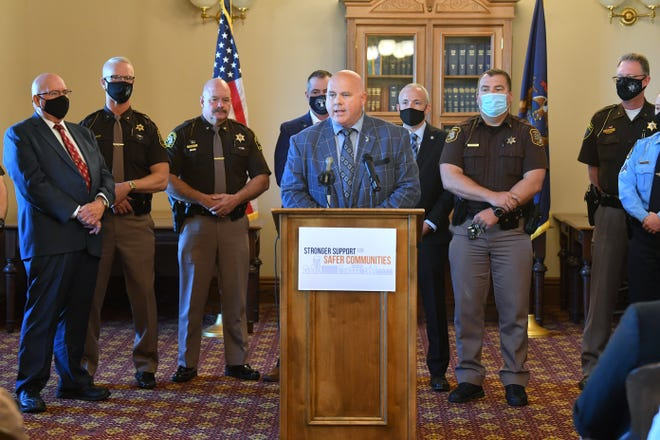 State Rep. TC Clements, R-Temperance, is joined by Michigan law enforcement officers for the unveiling of the Stronger Support for Stronger Communities plan.
