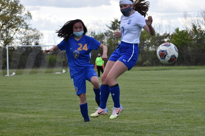 Kiera Eby of Ida (left) and Dundee's Evie Brandys battle for the ball Wednesday. Dundee won 1-0.