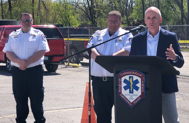 Chris O'Donnell, board chairman of the Canandaigua Emergency Squad, is joined by Lt. David Hubble and Chief Matt Sproul in explaining the need for a new ambulance base.