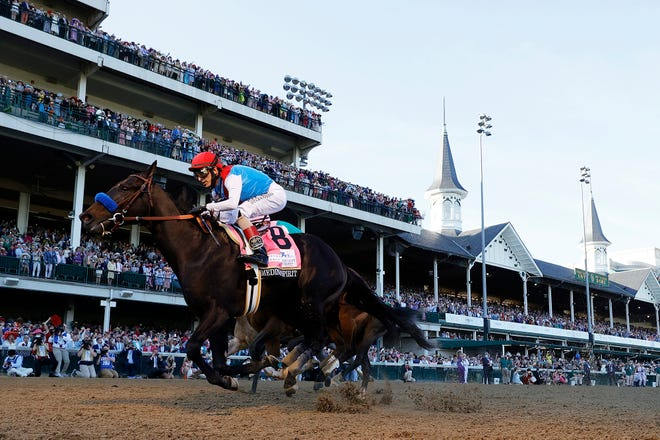 Medina Spirit, with John Velazquez up, crosses the finish line May 1 to win the 147th running of the Kentucky Derby at Churchill Downs in Louisville, Kentucky.