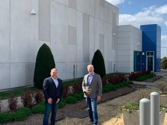 Terry Morrison and John Parsons stand outside the EdgeX Data Center in Oklahoma City.
