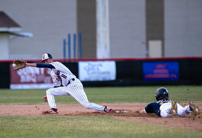 Land O' Lakes' Brian Holiday slides into second as the ball gets away from Vanguard shortstop Cody Antonucci. The Gators defeated the Knights, 3-0, in the Class 5A Region 2 baseball semifinals at Vanguard Wednesday night.