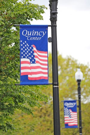 Signs welcoming people to Quincy Center on Thursday, May 13, 2021.