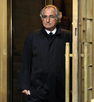 Bernard L. Madoff leaves federal court after a hearing regarding his bail Jan. 14, 2009, in New York. Madoff died April 14 in a federal prison in North Carolina.