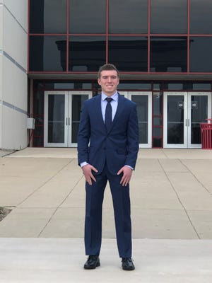 Pekin Community High School valedictorian Ethan Sidell stands for a photo.