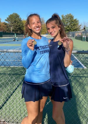 Petoskey's Chelsea Shampine (right) and Annabel Wilcox both earned BNC flight titles on Thursday in Traverse City.