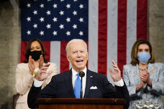 WASHINGTON -- President Joe Biden speaks to a Joint Session of Congress on April 28, in the House Chamber at the U.S. Capitol as Vice President Kamala Harris, left, and House Speaker Nancy Pelosi of Calif., applaud.