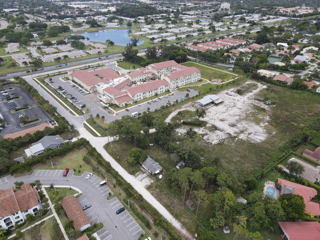 Tuscan Gardens, a congregate-living center in suburban Delray Beach, in May 2021 said it wants to expand its site onto the dirt area at right.