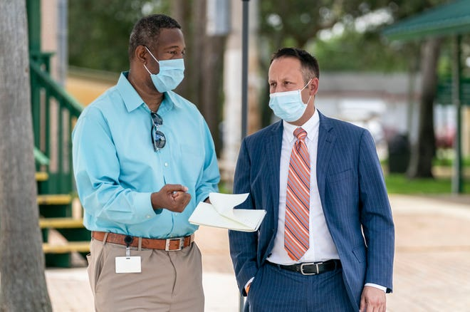 Palm Beach Post reporter Wayne Washington talks to Palm Beach County Mayor Dave Kerner at a press conference at a mobile testing site for the coronavirus at the Greenacres Community Center on June 11, 2020 in Greenacres, Florida.