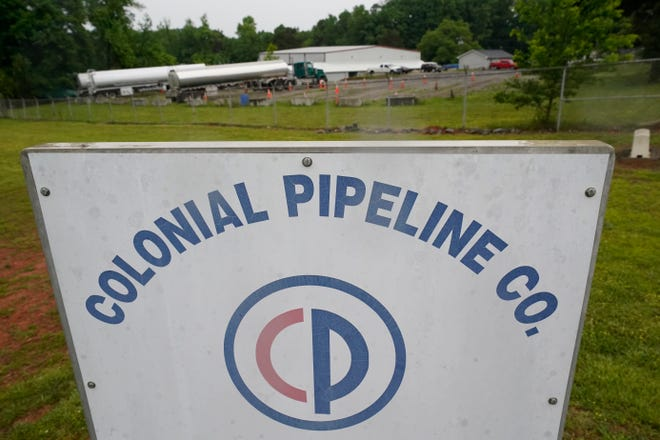 Tanker trucks are parked near the entrance of Colonial Pipeline Company May 12 in Charlotte.