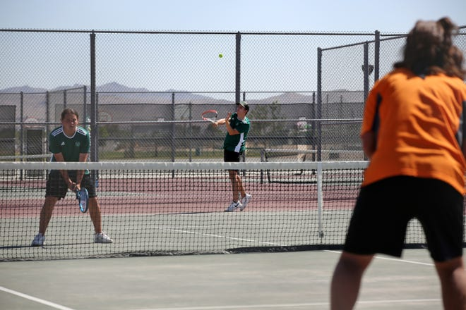 The Burros' No. 1 doubles team, Andrew Sliva and Carson Palomino, almost forced a tie-breaker against the Sun Devils' No. 1 doubles team Monday afternoon. The Burroughs High School boys tennis team finished its season 10-0 after defeating Apple Valley 11-7.