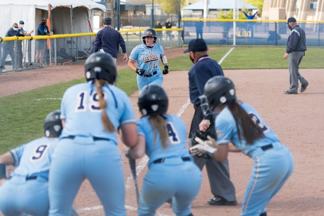 Teammates wait to greet Kent State senior Olivia Sborlini at home plate after she homered against Akron on Wednesday at the Diamond at Dix.