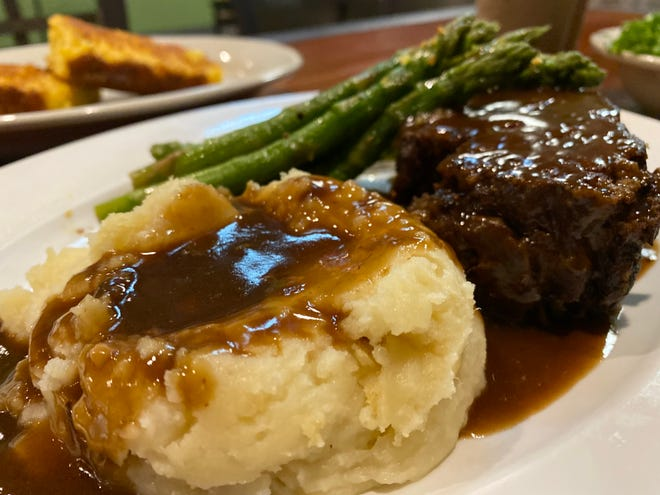 Samantha's new downtown Canton location features homemade dishes, including meatloaf. The new location at 217 Market Ave. N is larger and includes upstairs and downstairs bars.