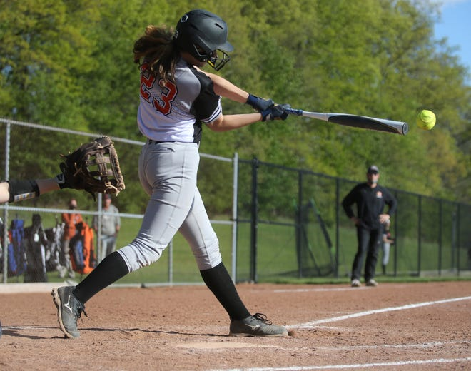 Green's Kylie Gorsuch gets a hit in Wednesday's Division I sectional final game against Louisville. The Bulldogs beat the Leopards 10-1.