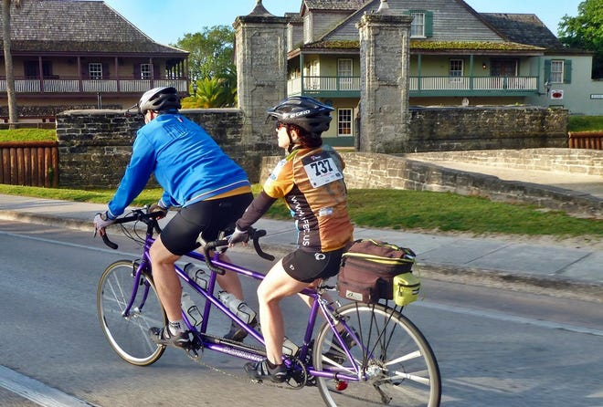A tandem riding past the Old City Gates of St. Augustine during the Tour De Forts Classic 2016. This year's Tour de Forts Classic is May 23.