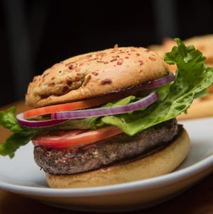 Gecko's Grill & Pub, with multiple locations in Sarasota and Manatee, offers USDA Choice Angus Chuck burgers with plenty of toppings options.