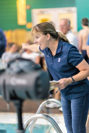 Shawnee swimming coach Valarie Colburn shouts instructions during a meet.