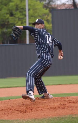 Shawnee senior pitcher Brylen Janda (14) makes the delivery during the 2021 season.