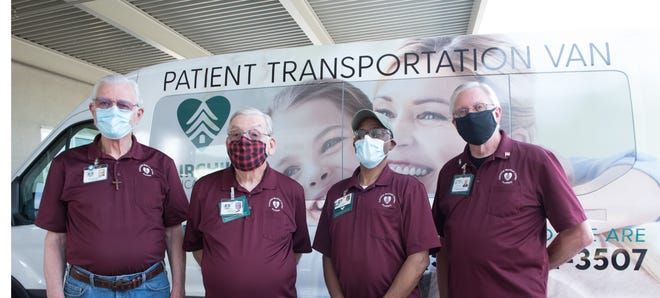 After being on hiatus for more than a year due to the COVID-19 pandemic, the patient transportation van at Fairchild Medical Center in Yreka is back in service. From left to right are volunteer van drivers Milt DeBuhr, Tom Brass, Harold McFall, and Michael Dalton.