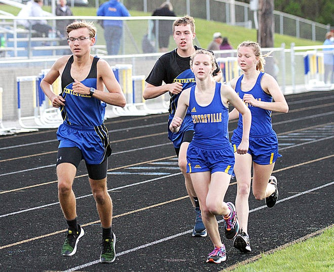 Centreville's Carson Hunter, Ben Reed plus Abby Schlabach and Gabby Schlabach run in the two-mile event at Centreville on Wednesday.