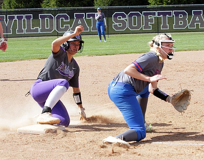 Kali Heivilin of Three Rivers slides safely into third base on Wednesday afternoon against Edwardsburg.