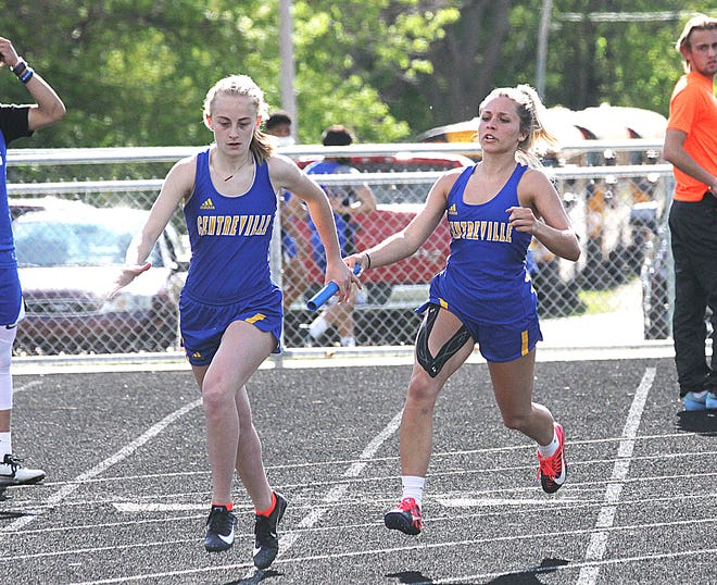 Avian Younts of Centreville hands the baton off to Zoe Miller for the final leg of the 400 relay on Wednesday.