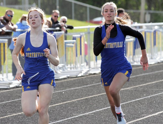 Centreville's Autumn Major (left) and Danielle Stauffer finish up the 400 run on Wednesday evening. Stauffer won the race.