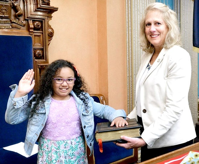 Aaleyah Tomorrow takes a ceremonial oath of office during her visit as junior senator for the day at the Capitol with Sen. Kim LaSata. The third grade student from Three Rivers won LaSata's March is Reading Month literacy challenge.