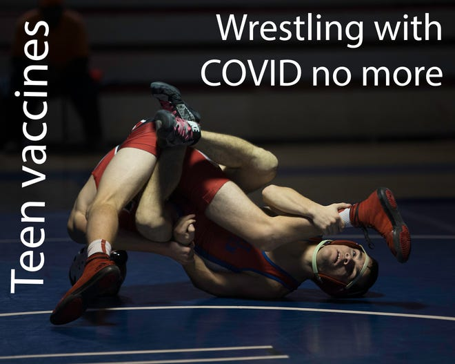 12-16-year-olds -- athletes and otherwise-- no longer need to wrestle with COVID as vaccinations for their age group has been approved. In this 2015 photo, a New Bern Bears wrestler takes on an opponent at New Bern High School.