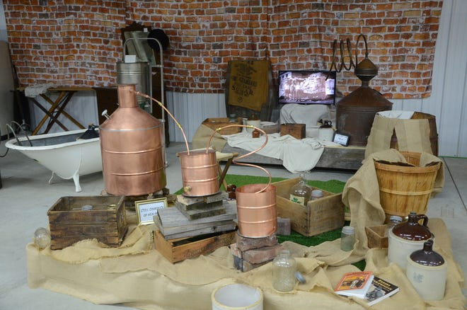 Moonshine stills made from materials including copper and a bathtub are among items on display as part of the Crawford County Historical Museum's bootlegging exhibit.