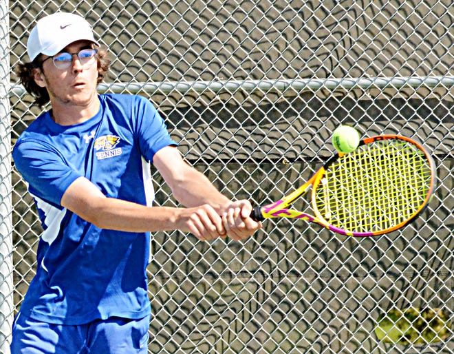 Aberdeen Central's Henry Fouberg volleys during the doubles match at Watertown on Thursday.