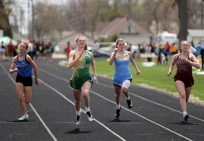 Aberdeen Roncalli sprinter Morgan Fiedler leads Hamlin's Justine Poppen in the 100 meter dash at Thursday's Northeast Conference meet at Doney Field. American News photo by Jenna Ortiz, taken 05/13/2021.