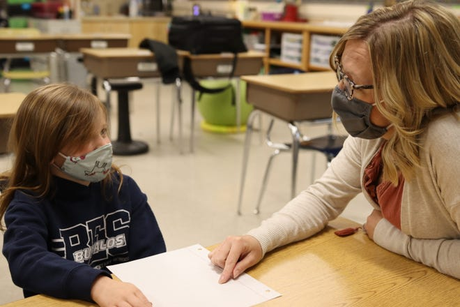 Berryton Elementary's Alyssa Metcalf helps one of her third-grade students with classwork Tuesday morning. The school this spring became the first in the nation to achieve a Quantum Learning School designation for its commitment to the professional development philosophy.