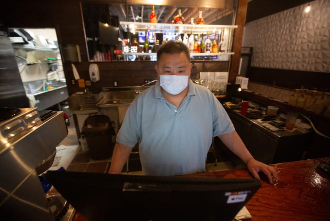 Viet Lam, owner of 4Guys Bistro, 732 S. Kansas Ave., mans the ordering computer during Thursday's lunch hour. Lam is one of many Kansas employers who say they are struggling to hire workers, something he believes is in part due to federal unemployment programs.