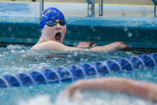 Washburn Rural's Makenna Pritchard reacts to her time of 55.55 to win the 100-yard freestyle against fierce competition at Thursday's Centennial League Championships at Capitol Federal Natatorium. Pritchard helped lead the Junior Blues to the team title as well.