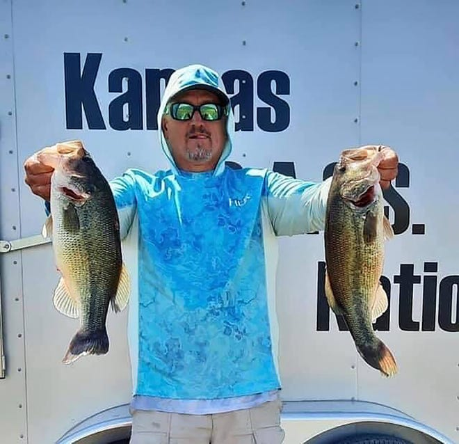 Leavenworth's Larry Stoafer holds up two of his best fish after posting an 18.27-pound bag on Day 1 of the Mr. BASS tournament, which ran from May 1-2 on Glen Elder Reservoir. Stoafer won in the boater's division.