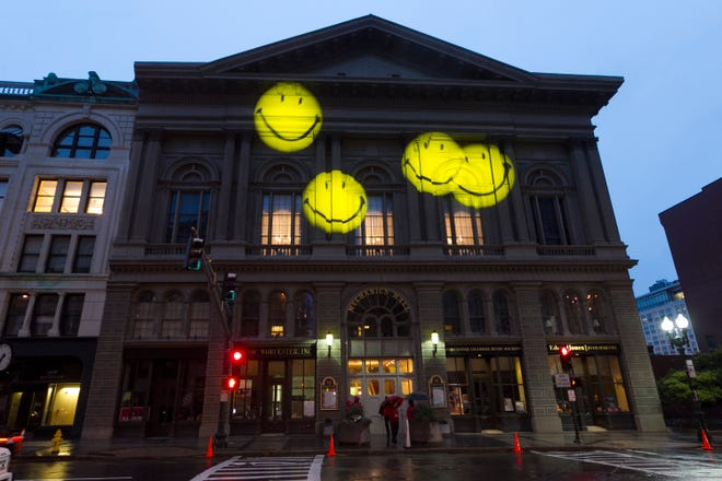 Mechanics Hall in downtown Worcester is lit up with smiley faces.