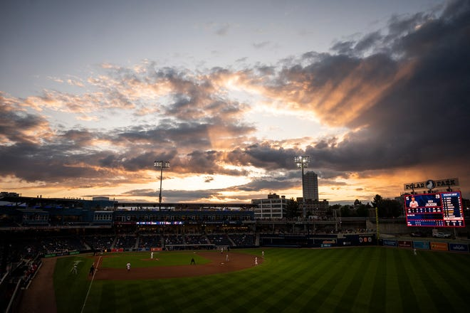 The sun sets over Polar Park as WooSox fans enjoy the first night game against the Syracuse Mets on Wednesday, May 12, 2021.