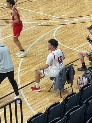 Thomas Carr, an assistant coach for Team Loaded NC's 16-and-under AAU basketball team, dressed in full uniform for a game last weekend as a motivational tactic.