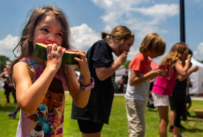 Mackenzie Dillon competes in the watermelon eating contest during the Newberry Watermelon Festival in 2019. [The Gainesville Sun/File]