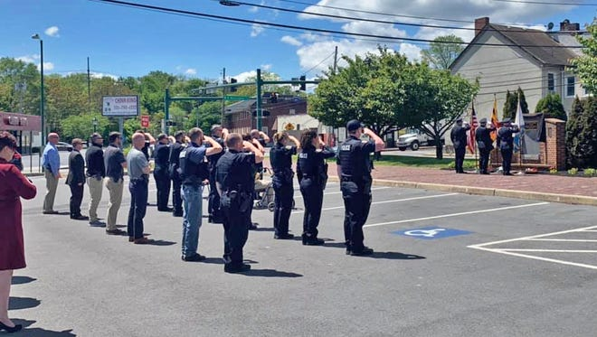 Current and retired members of the Hagerstown Police Department, along with some city officials, pay tribute to fallen police officers during a ceremony Wednesday at police headquarters.