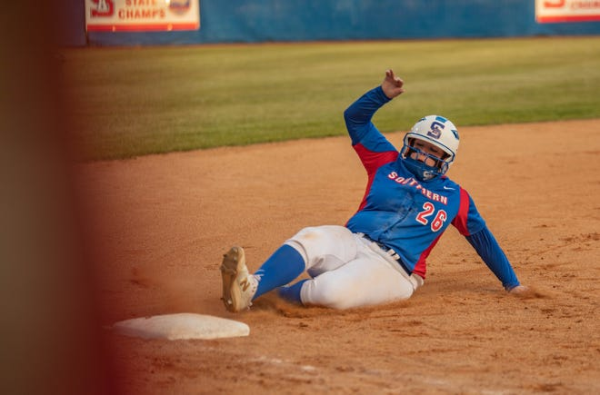 Southern Alamance's Shelby Lapoint slides into third base in a game against Southeast Guilford earlier this season.